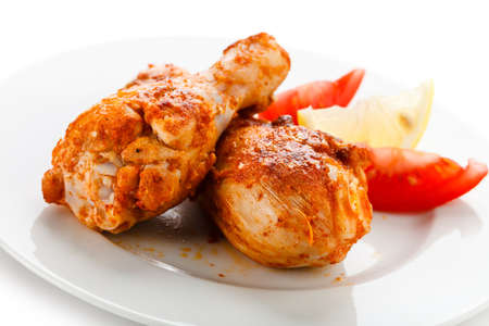 roast chicken: Roasted chicken drumsticks and vegetables Stock Photo