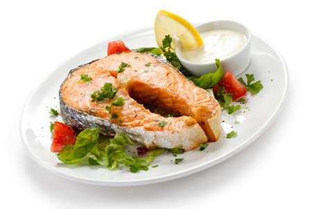 sauce dish: Grilled salmon and vegetables Stock Photo