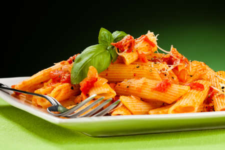 grated cheese: Pasta with tomato sauce and parmesan Stock Photo