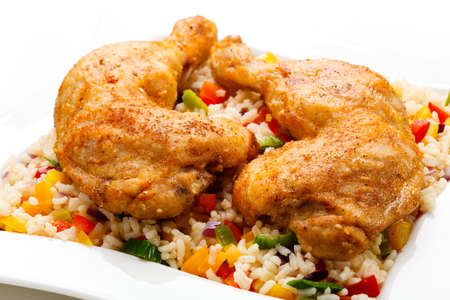 Roasted chicken legs, rice and vegetables photo
