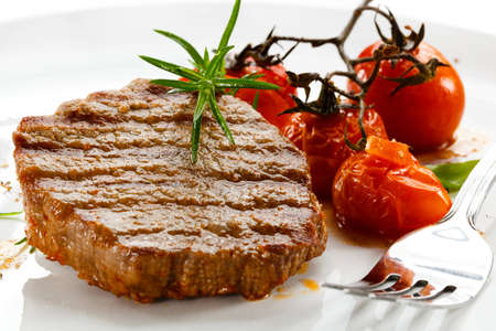 loin chops: Grilled beefsteaks and vegetables
