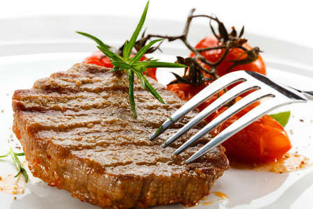 Grilled beefsteaks and vegetables photo