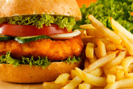 chicken breast: Big hamburger, French fries and vegetables Stock Photo