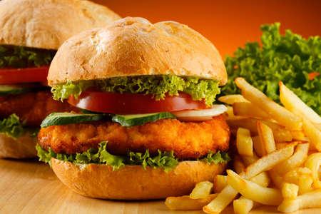 big breast: Big hamburger, French fries and vegetables Stock Photo