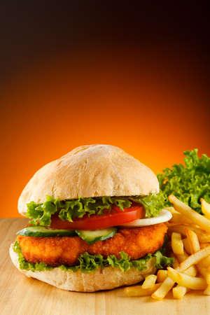 Big hamburger, French fries and vegetables Stock Photo - 15221975