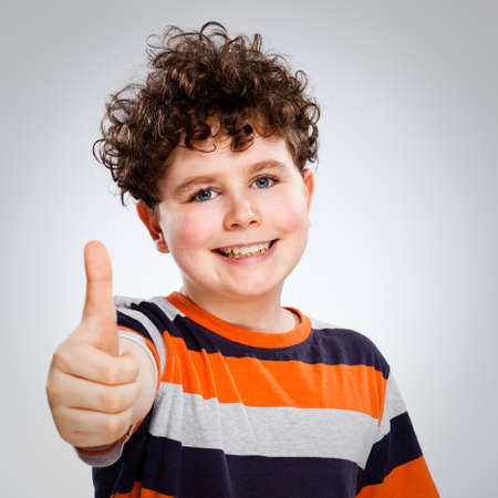 ok hand: Portrait of young boy showing ok sign