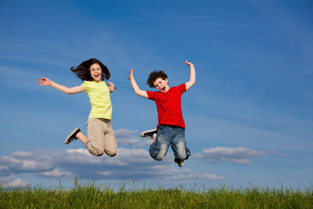 Girl and boy jumping, running outdoor photo