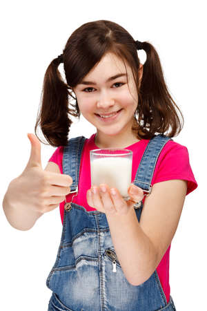 Girl holding glass of milk isolated on white background