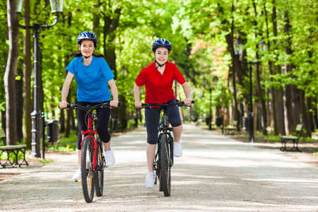 Girls riding bikes Stock Photo