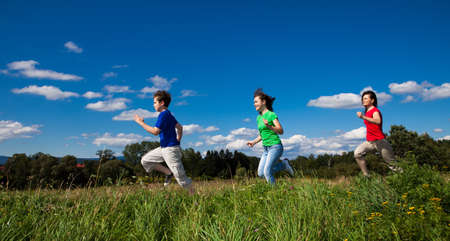 Active family - mother and kids running outdoor photo