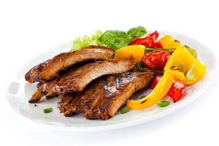 Tasty grilled ribs with vegetables photo