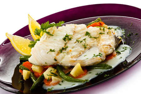 Fish dish - fish fillet in sauce and vegetables photo
