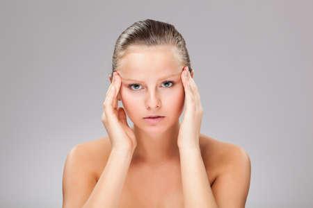Woman massaging pain head Stock Photo - 15406285