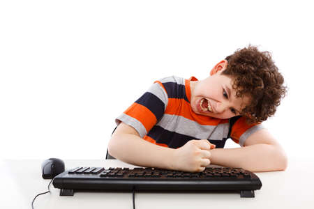 angry teenager: Boy using computer isolated on white background
