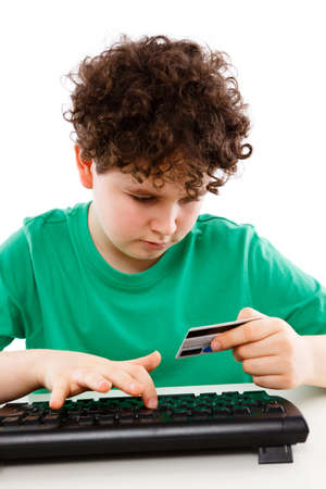 Online payment - boy using credit card photo