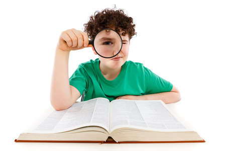 Boy looking through magnifying glass isolated on white Stock Photo - 15403152