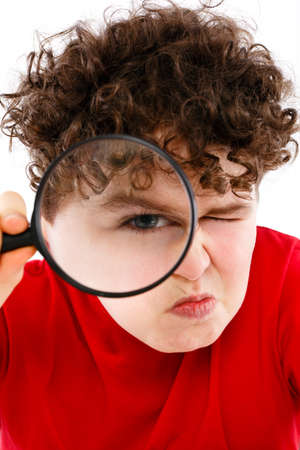 Boy looking through magnifying glass isolated on white Stock Photo - 15403153