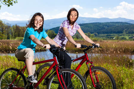 Girls riding bikes photo