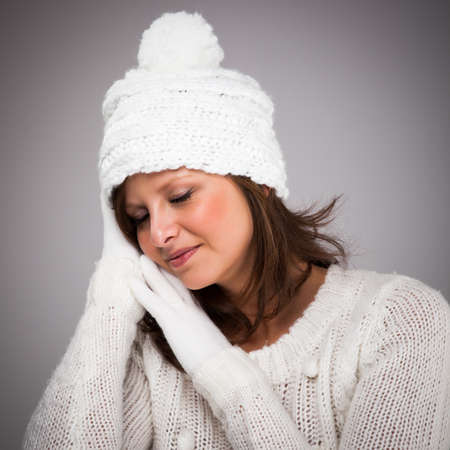 Young attractive woman dressed in winter clothes photo