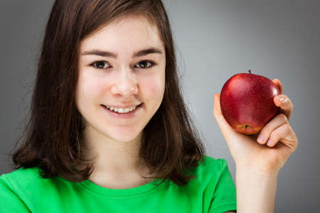 kids eating healthy: Girl holding apple