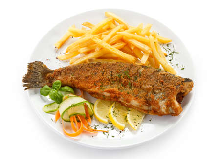 fries: Fish dish - fried fish, French fries and vegetables Stock Photo