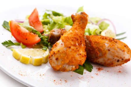 roasted chicken: Roasted chicken drumsticks and vegetables Stock Photo