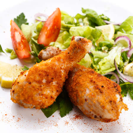 chicken grill: Roasted chicken drumsticks and vegetables Stock Photo