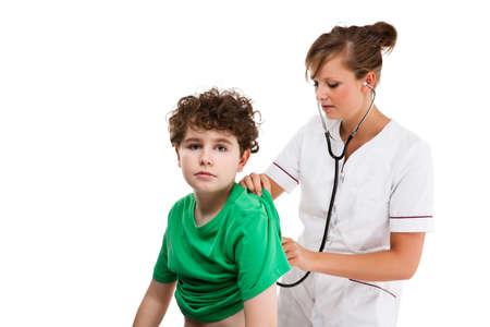 stethoscope boy: Doctor examining young boy isolated on white background