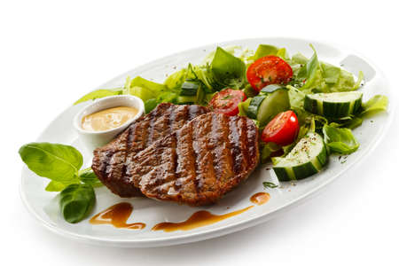 grilled meat: Grilled steaks and vegetables