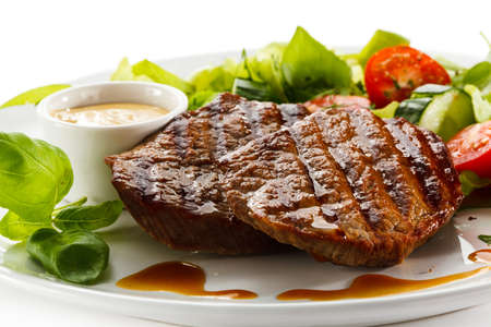 beef meat: Grilled steaks and vegetables