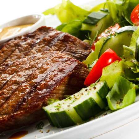 Grilled steaks and vegetables