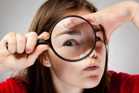 inspector kid: Girl holding magnifying glass Stock Photo