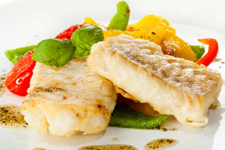 Fish dish - fried fish fillets and vegetables photo