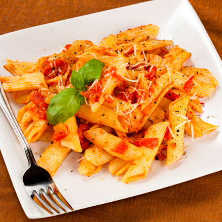 Pasta with tomato sauce and parmesan photo