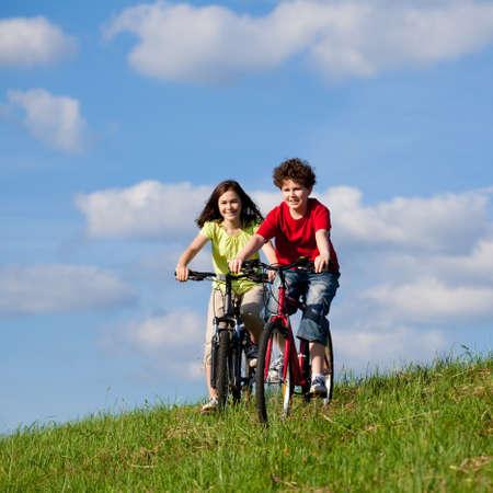 Girl and boy biking Stock Photo - 15612257