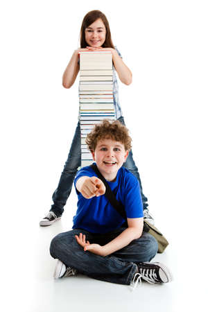 Students sitting close to pile of books on white photo