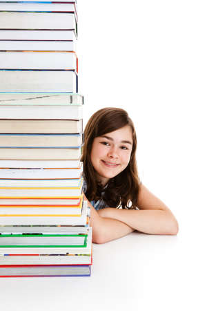 Girl behind pile of books isolated on white background photo