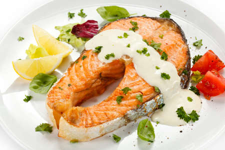 omega 3: Grilled salmon and vegetables Stock Photo