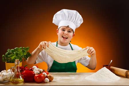 champignons: Boy making pizza dough Stock Photo