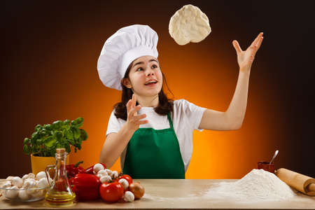 cooking oil: Girl making pizza dough Stock Photo