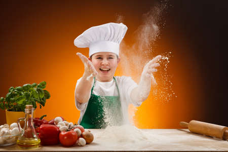 biscuit dough: Boy making pizza dough Stock Photo