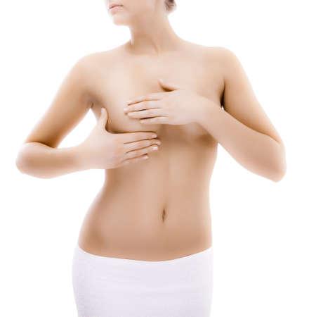 femme se deshabille: Seins de femme examinant isol� sur fond blanc