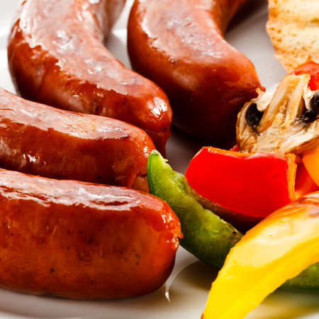 Grilled sausages, bread and vegetables Stock Photo - 15725425