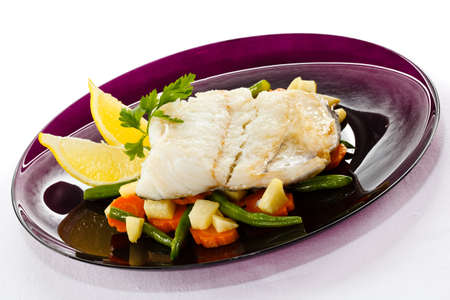 Fish dish - fish fillet and vegetables photo