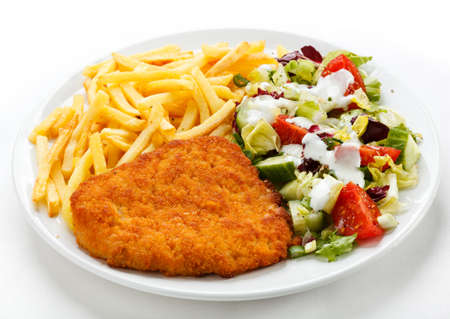 cutlets: Pork chop, French fries and vegetables Stock Photo