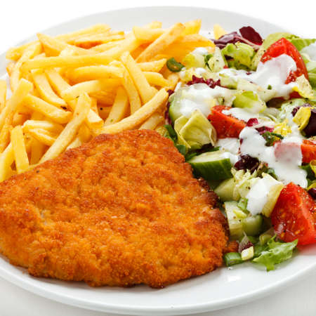 schnitzel: Pork chop, French fries and vegetables Stock Photo