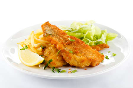 fried fish:  Fish dish - fried fish fillet, French fries with vegetables
