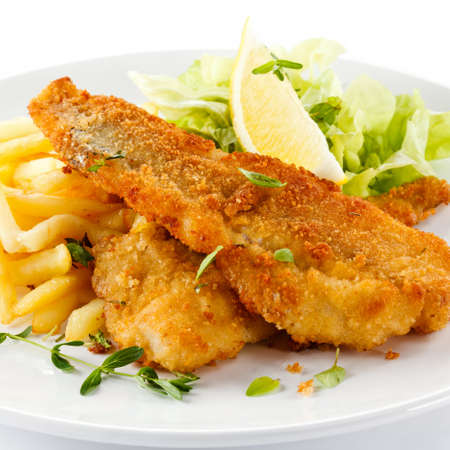 Fish dish - fried fish fillet, French fries with vegetables