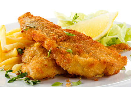 grilled fish:  Fish dish - fried fish fillet, French fries with vegetables