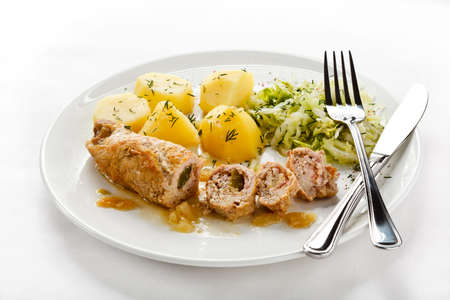 roulade: Roasted stuffed pork chop and vegetables